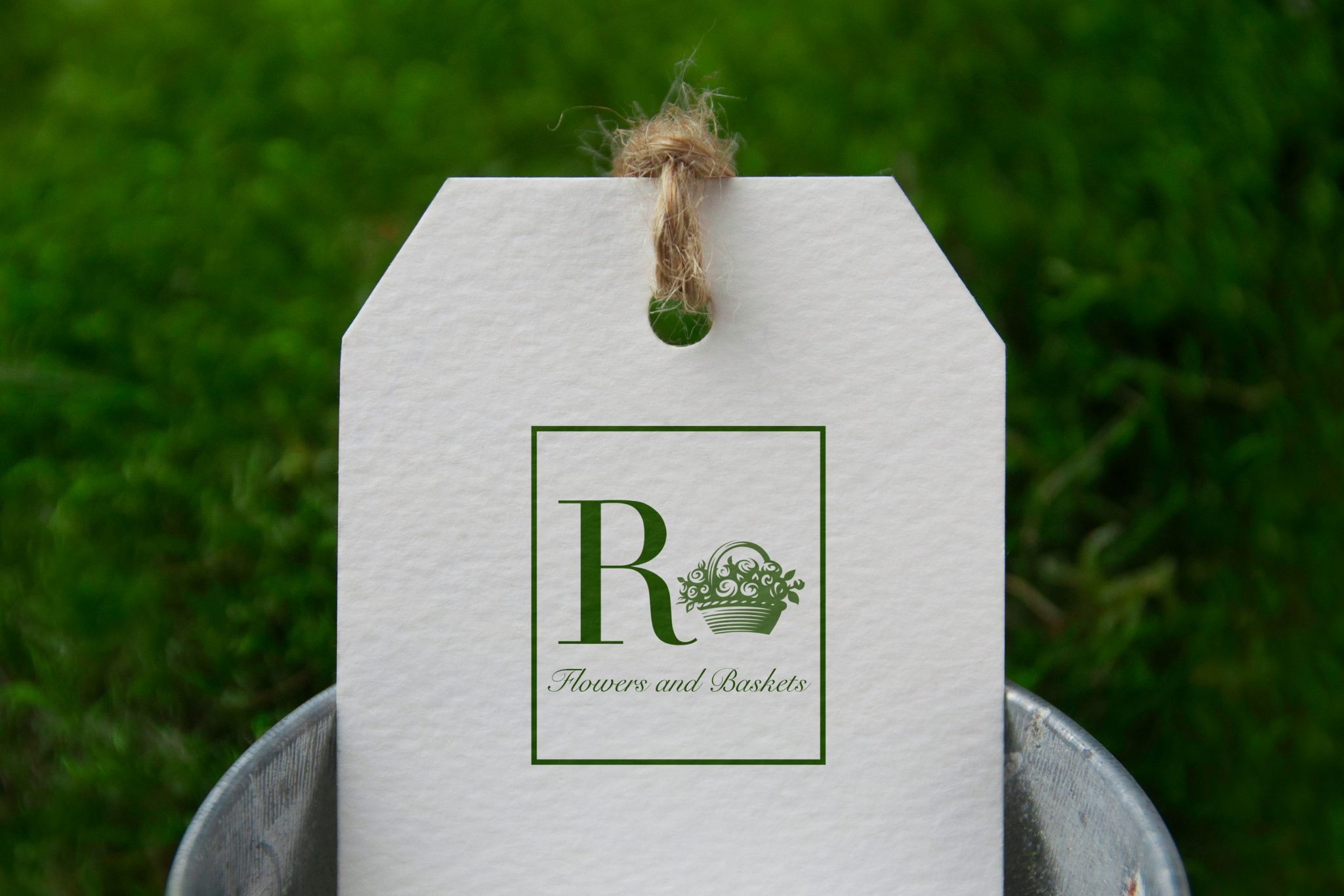 Logo for R Flowers and Baskets, local florist